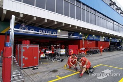 Ferrari team members prepare pitlane area