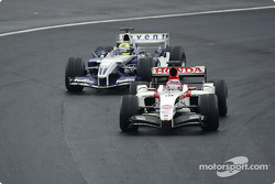 Takuma Sato and Ralf Schumacher battle