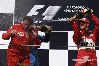 Podium: champagne for Jean Todt and Michael Schumacher