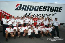 Bridgestone team members celebrate Ferrari's 2004 Constructors World Championship