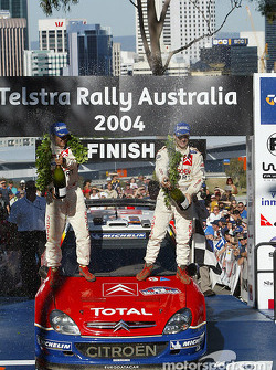 Podium: champagne for rally winners Sébastien Loeb and Daniel Elena