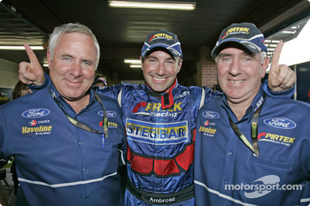 Australian V8 Supercar Series 2004 champion Marcos Ambrose celebrates with team owners Ross and Jimmy Stone