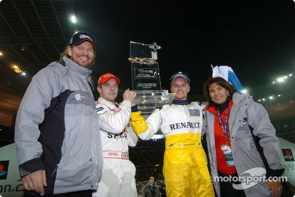 The Race of Champions 2004 winner Heikki Kovalainen with runner-up Sébastien Loeb, Fredrik Johnsson and Michèle Mouton
