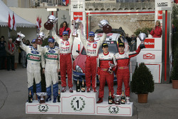 Podium: winners Sébastien Loeb and Daniel Elena, with Toni Gardemeister and Jakke Honkanen, and Gilles Panizzi and Hervé Panizzi