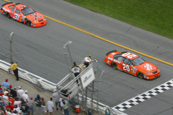 Tony Stewart takes the checkered flag ahead of Jeff Burton