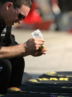 Sharpie-Crown Royal crew member prepares wheels