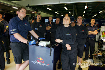 Red Bull Racing team members watch qualifying