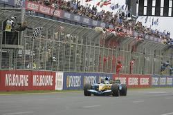Giancarlo Fisichella takes the checkered flag