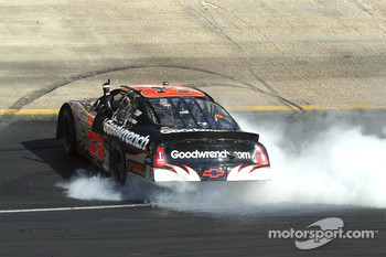 Race winner Kevin Harvick celebrates with a burnout