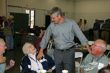 1998 Indianapolis 500 winner Eddie Cheever, right center, visits with Tom Carnegie, left center, and Charlie Walker, right, of the Indianapolis Motor Speedway Public Address staff