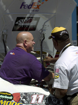 NASCAR inspectors check out the FedEx #11