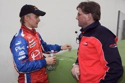 Race winner Heikki Kovalainen celebrates with race engineer Mick Cook