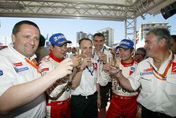 Rally winners Sébastien Loeb and Daniel Elena celebrate with their team