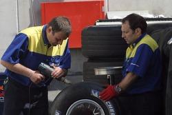 Michelin team members prepare tires