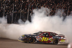 Race winner Greg Biffle celebrates