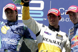Podium: race winner Jose Maria Lopez with Nelson A. Piquet and Scott Speed