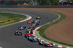 First corner: Jarno Trulli leads a group of cars