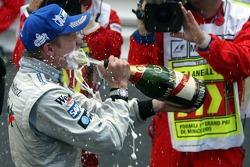 Champagne for race winner Kimi Raikkonen