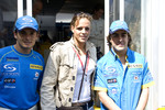Giancarlo Fisichella and Fernando Alonso with swimmer Laure Manaudou