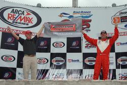 Pole winner Jimmy Vasser celebrates