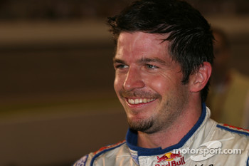 Patrick Carpentier celebrates third place finish