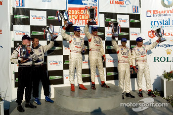 P1 podium: class and overall winners JJ Lehto and Marco Werner, with Frank Biela and Emmanuele Pirro, and James Weaver and Butch Leitzinger
