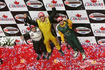 Podium: race winner Justin Wilson with Oriol Servia and Alex Tagliani