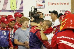 Victory lane: race winner Dario Franchitti celebrates with Tony Kanaan