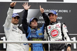 Podium: race winner Fernando Alonso with Juan Pablo Montoya and Jenson Button