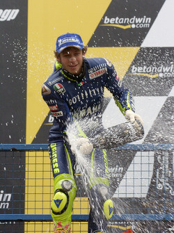 Podium: champagne for Valentino Rossi