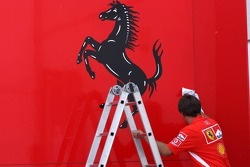 Ferrari team member cleans up the transporters