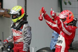 Ralf Schumacher and Michael Schumacher celebrate podium finish