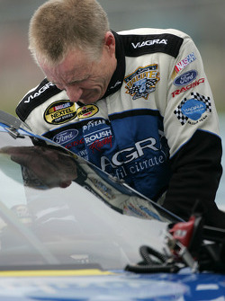 Mark Martin gets in his car