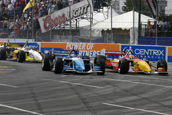 Paul  Tracy leads Sébastien Bourdais into turn 1