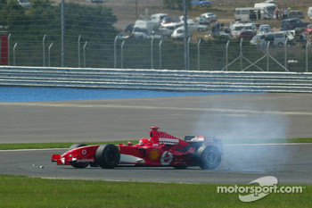 Michael Schumacher after his crash with Mark Webber