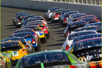 Cars bunch up for the start of the race