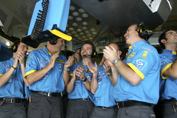 Renault F1 team members celebrate as Fernando Alonso sets the fastest time