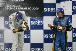 Podium: champagne for Juan Pablo Montoya and Fernando Alonso