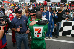 2005 IRL champion Dan Wheldon celebrates with Tony Kanaan