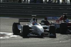 Nico Rosberg passes Ernesto Viso for the lead