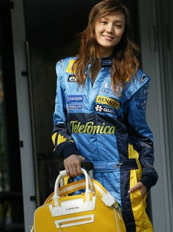 A Renault girl poses