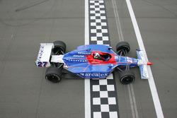 Dario Franchitti takes the checkered flag