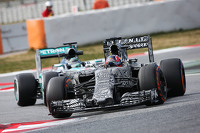 Daniil Kvyat, Red Bull Racing RB11 leads Nico Rosberg, Mercedes AMG F1 W06