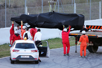 The McLaren MP4-30 of Jenson Button, McLaren is recovered back to the pits on the back of a truck