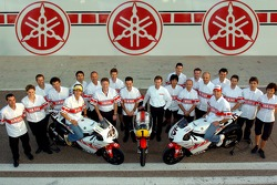 Yamaha's 50th anniversary celebration: Valentino Rossi and Colin Edwards pose with Yamaha team members
