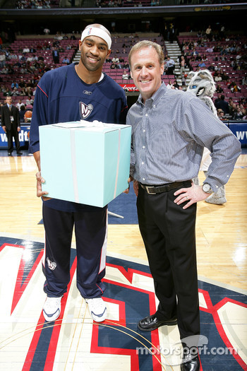 Rusty Wallace and Vince Carter #15 of the New Jersey Nets take part in a presentation before the start of the game against the Detroit Pistons at the Continental Airlines Arena in East Rutherford, New Jersey