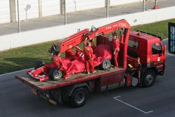 The Ferrari of Michael Schumacher back in the pits on a transporter