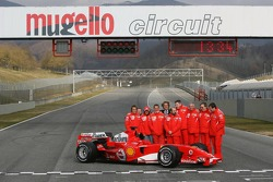 Michael Schumacher, Felipe Massa and Luca Badoer with Ferrari team members