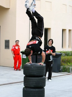 An acrobat entertains the paddock