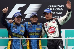 Podium: race winner Giancarlo Fisichella with Fernando Alonso and Jenson Button